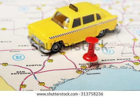 Close up of  Houston  USA map with red pin and taxi car toy - Travel concept - stock photo