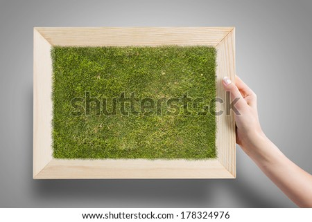 Close up of human hand holding frame - stock photo