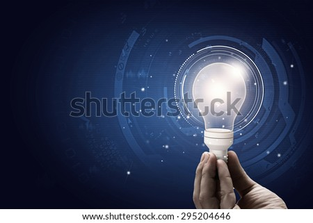 Close up of human hand holding light bulb - stock photo