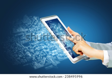 Close up of human hand touching screen of tablet - stock photo
