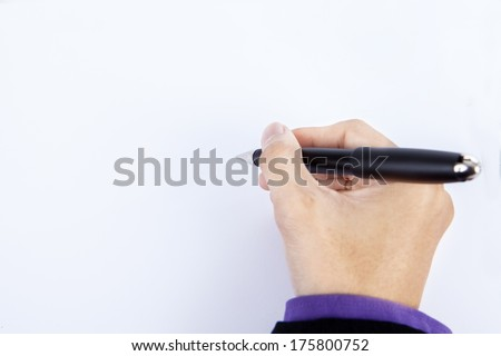 Close up of human hand writing with pen on whiteboard - stock photo