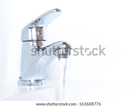 Close-up of human hands being washed under faucet in bathroom, isolated on white