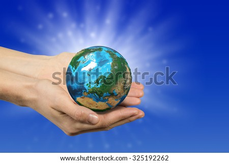 Close up of human hands holding Earth planet. Elements of this image are furnished by NASA - stock photo