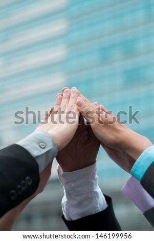 Close-up of human hands holding together - stock photo