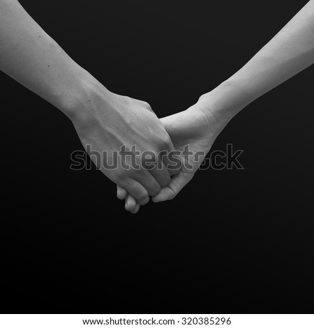close up of human hands holding together for helping and cheer up : helping hands concept :family and friends concept.hand of power family.abstract helping hand in black and white tone colors concept. - stock photo