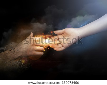 Close up of human hands reaching each other with fingers - stock photo