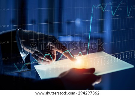 Close up of human hands using virtual panel - stock photo