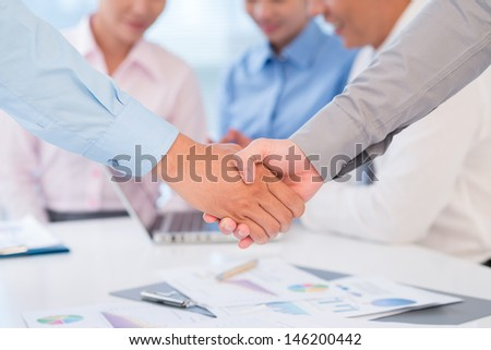 Close-up of human handshaking on the foreground - stock photo