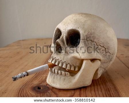Close up of human skull  smoking cigarette  - stock photo