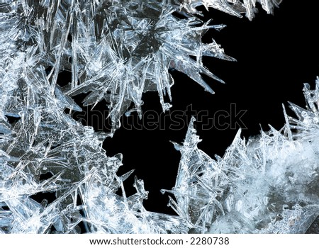 close up of ice crystals forming spiky ornaments - stock photo
