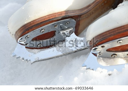 Close up of ice skating shoe at frozen lake in austria. - stock photo