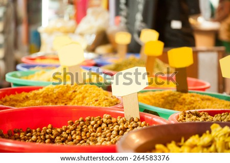 Close up of Indian colored spices at local market - stock photo