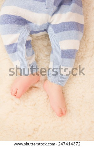Close up of infant baby feel on fur - stock photo
