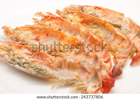 Close up of isolated eaten or leftover grilled shrimps / prawns for delicious seafood background - stock photo