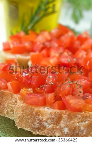 Close up of italian crostini with tomato and oil - stock photo