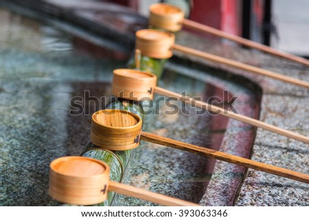Close up of japanes wooden ladle in shrine yufuin kyushu japan. - stock photo