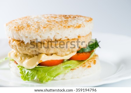 close-up of  Japanese food, grilled meat in Rice burger, served on plate (shallow DOF) - stock photo