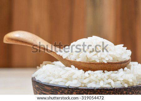 close-up of jasmine rice on wooden spoon