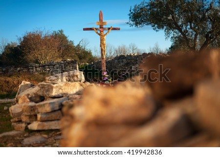 Close up of Jesus Christ crucifixion sculpture. Religion, belief and hope concept. - stock photo