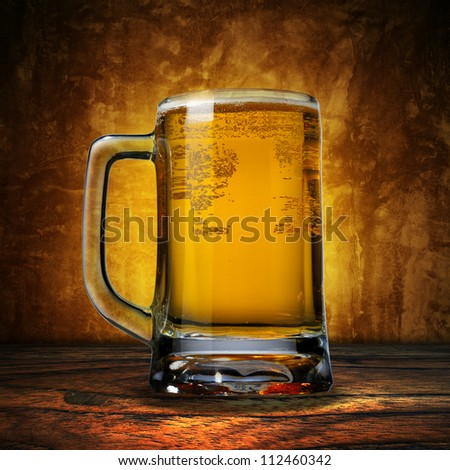Close up of jug of beer. Cold refreshment - stock photo
