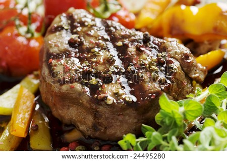 close-up of juicy tenderloin beef covered in crushed mix of pepper - stock photo