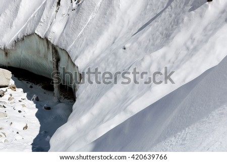 Close up of Khumbu glacier from Everest Base Camp, Himalayas, Nepal. Snowy slope of a glacier ice block lit by a bright sun light on a clear day. Himalayan glacier. - stock photo