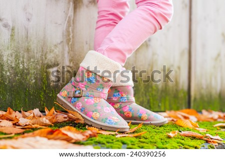 Close up of kid's boots outside - stock photo