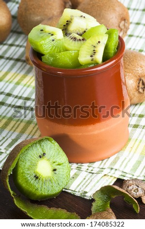 Close up of kiwi fruit in the clay jar