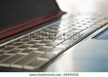 Close-up of laptop keyboard with buttons - stock photo