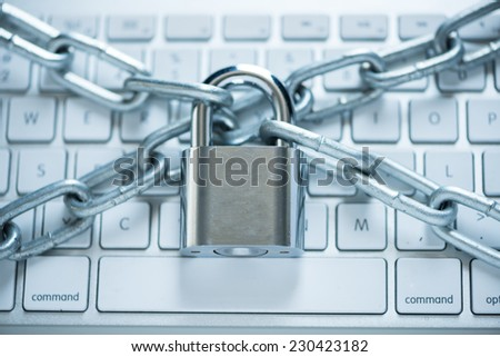 Close-up of laptop with chains and lock: information security concept