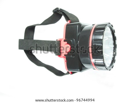 Close up of large head torch on white background - stock photo