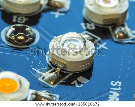 close up of laser diode, high power LED installed on blue circuit board - stock photo
