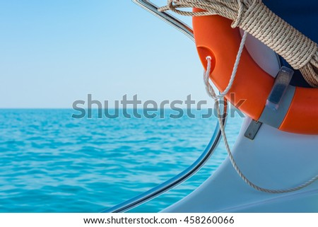 Close up of life buoy and rope on the speedboat. Selective Focus.