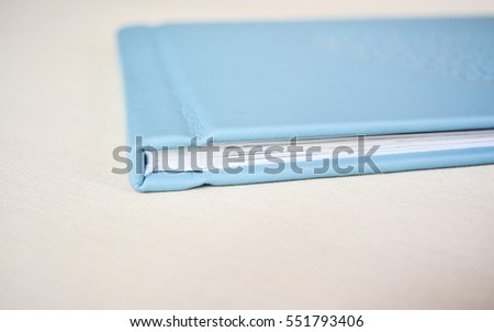 Close up of  light blue leather notebook on white background. Mini book of photo album.