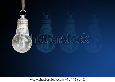 close up of light bulb on blue background. Copy space - stock photo