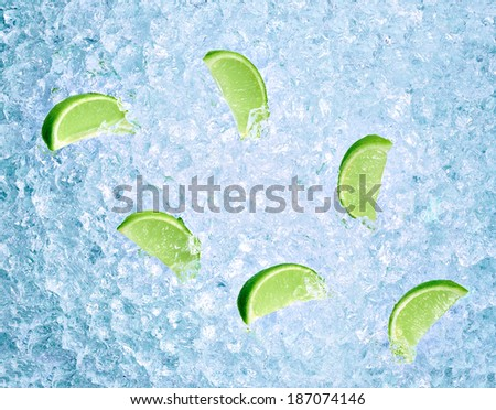 close up of lime slices on ice - stock photo