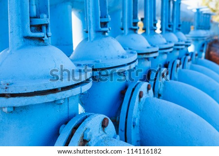Close up of line from blue oxygen gate valves with pipes - stock photo