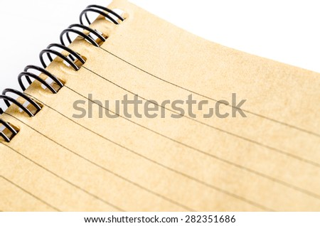 Close up of lined paper in brown diary made from paper recycle. - stock photo