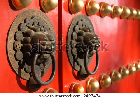 Close up of lion knob on a chinese temple door