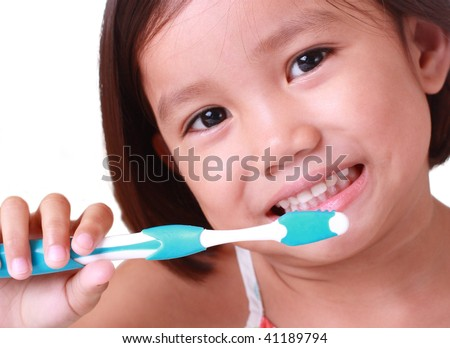 close up of little girl brushing her teeth