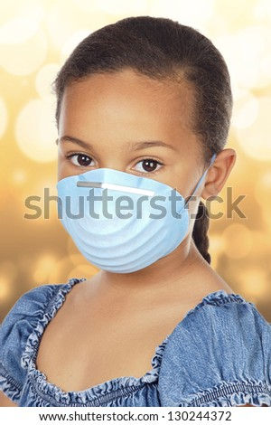 Close-up Of Little Girl Wearing Protective Mask - stock photo