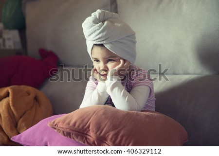 Close-up of little upset girl leaning her head on hands while looking away - stock photo