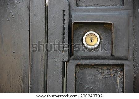 Close up of lock on black iron door. - stock photo
