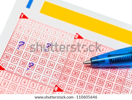 Close up of lottery ticket with a marked numbers and a pencil - stock photo