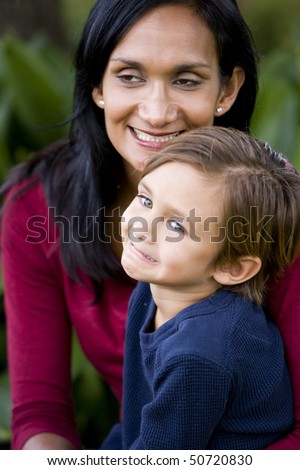 Close-up of loving Indian mother with young cute mixed-race 5 year old son - stock photo