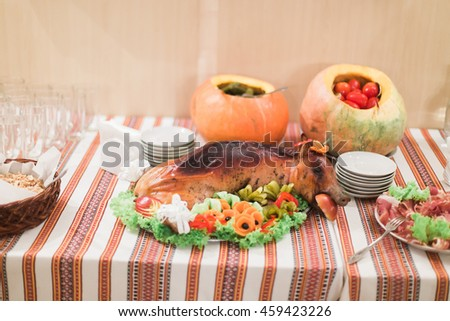 Close-up of luxurious rural-style catering table in restaurant ready for wedding celebration - stock photo