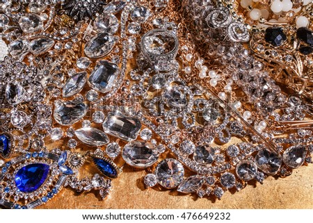 Close up of luxury jewelry on golden background