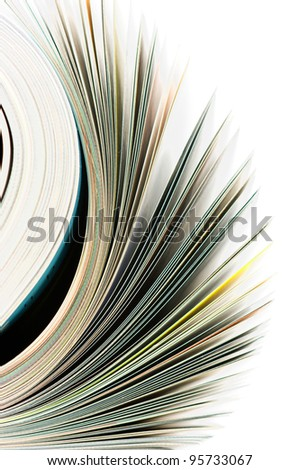 Close-up of magazine pages on white background. Shallow DOF, focus on edges. - stock photo