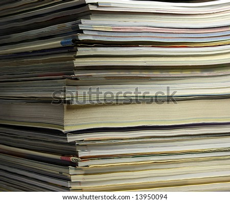 close-up of magazines pile