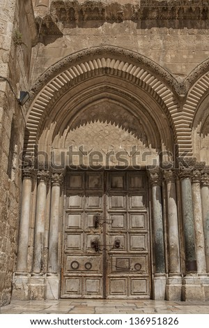 Close up of main entrance to the Church of the Holy Sepulchre in old city of Jerusalem - stock photo